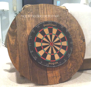 Circular wooden dartboard backboard
