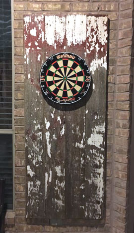 Old door dartboard surround