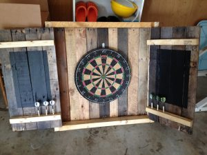 Upcycled palletwood dartboard cabinet